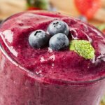 delicious smoothie with blueberry topped