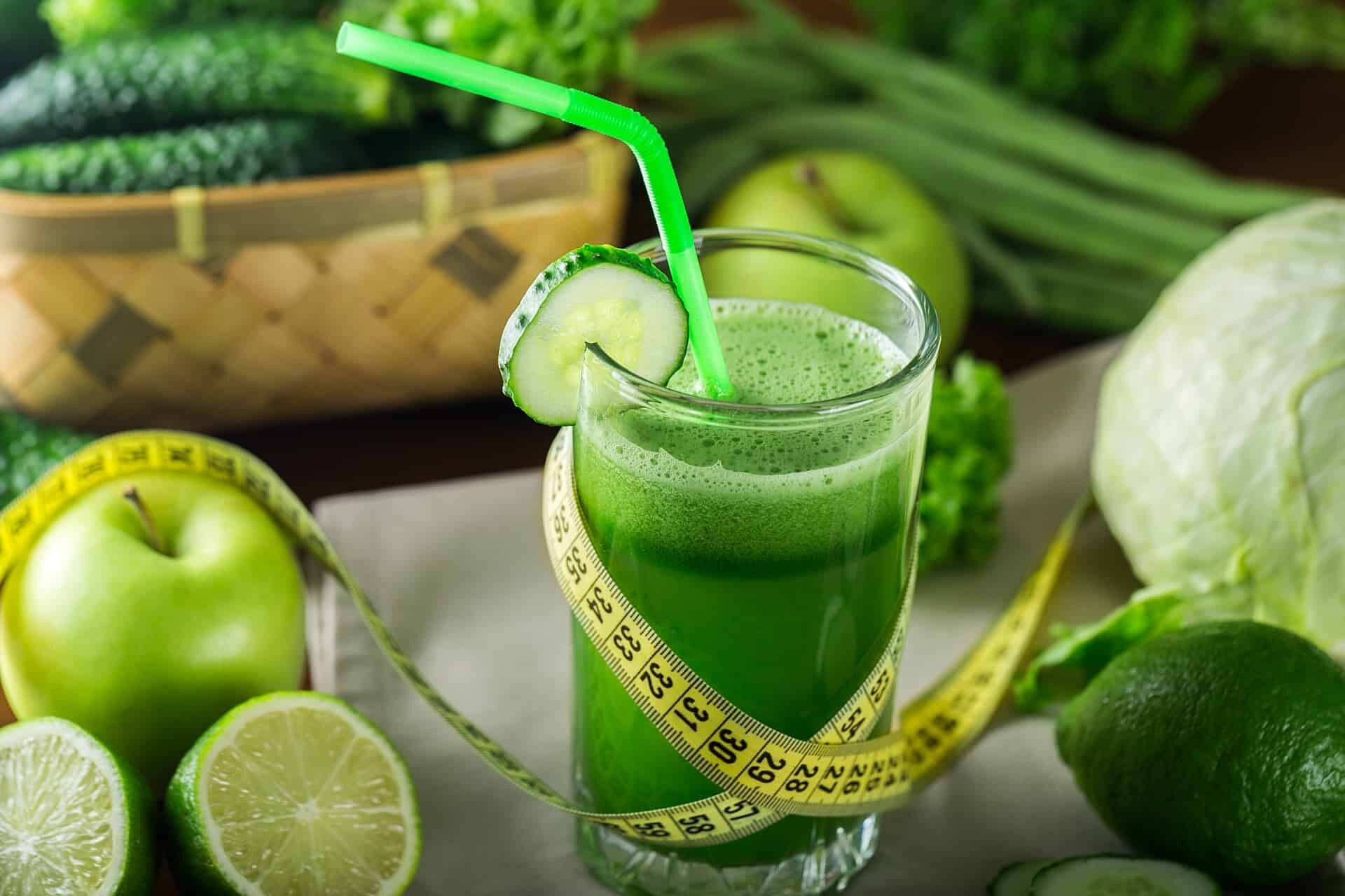 Green delicious juice with a tape measure