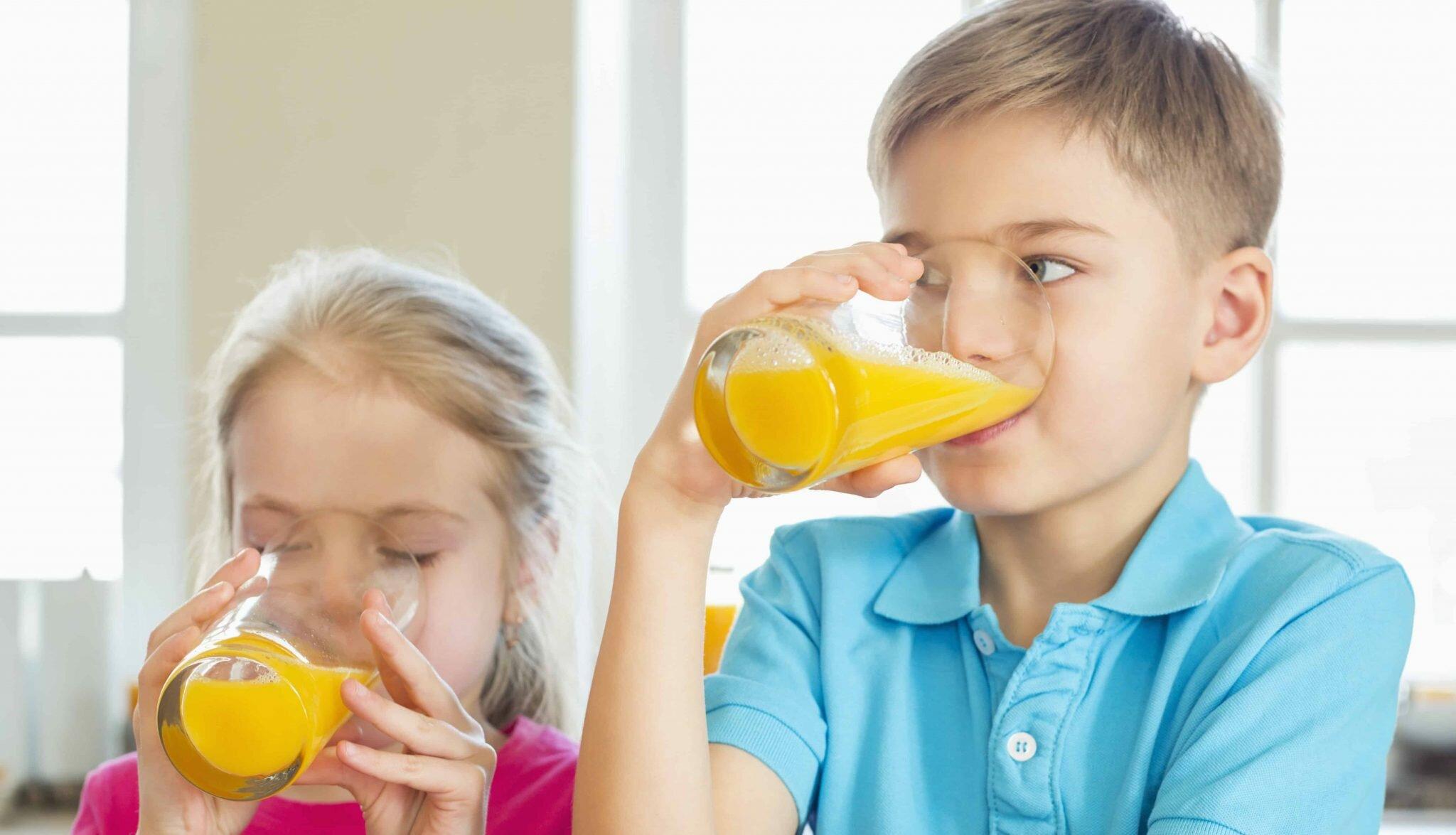 kids taking some orange juice