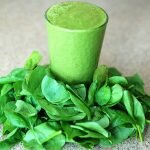 a glass of green smoothie