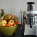 juicer with fruits on the side