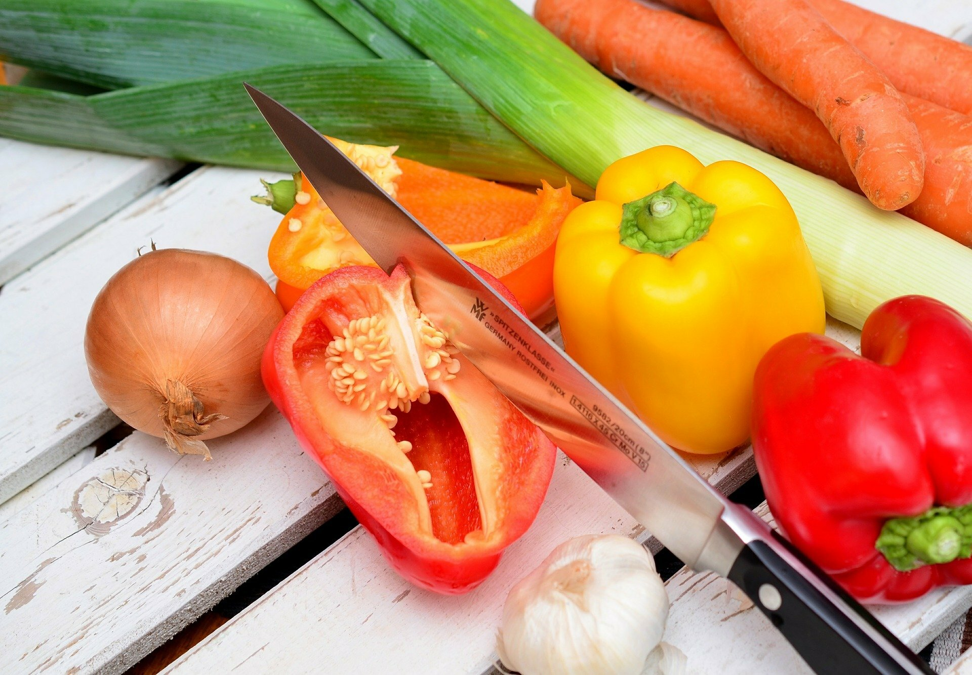 knife cutting vegetables
