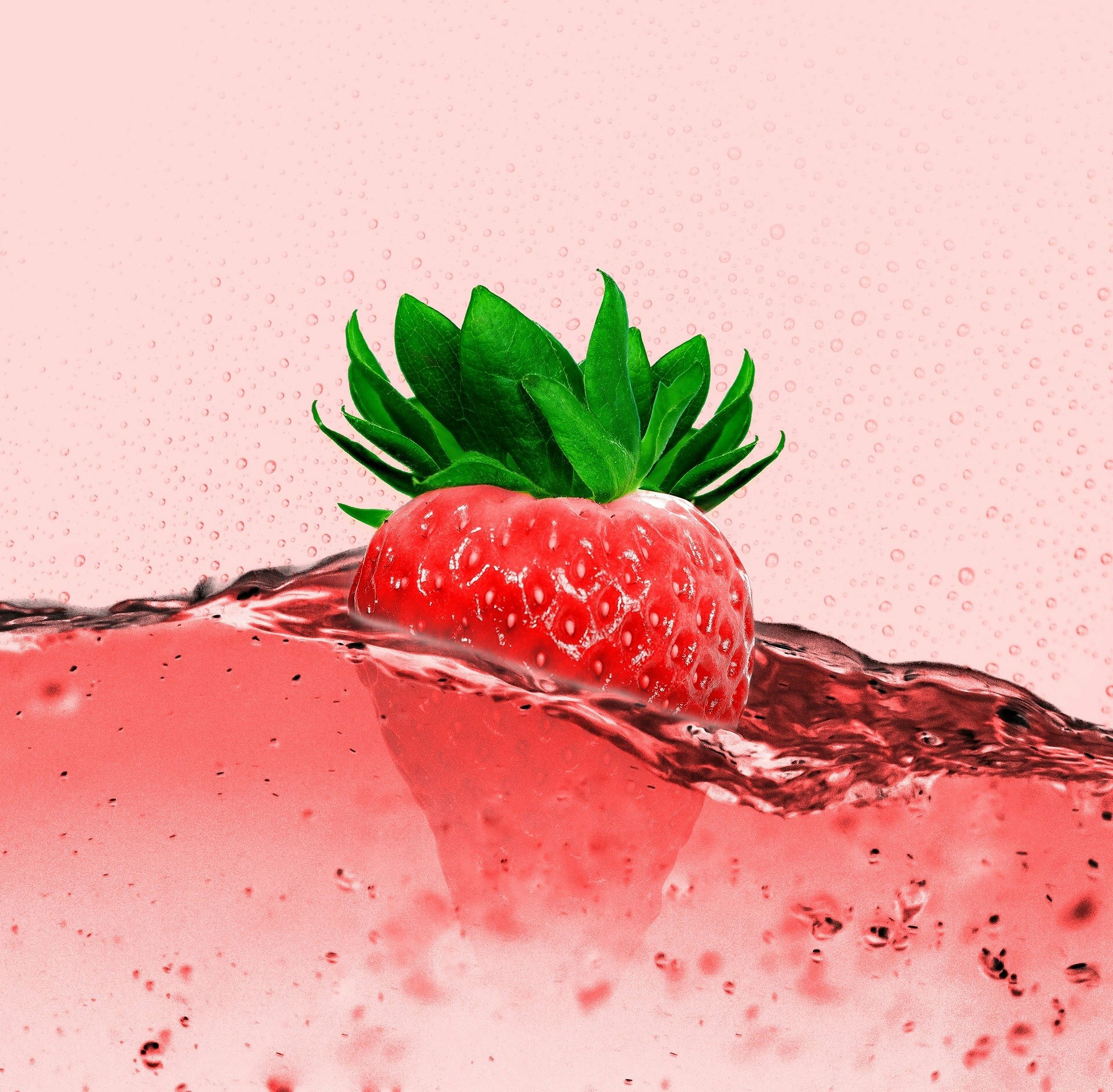 strawberry floating in juice